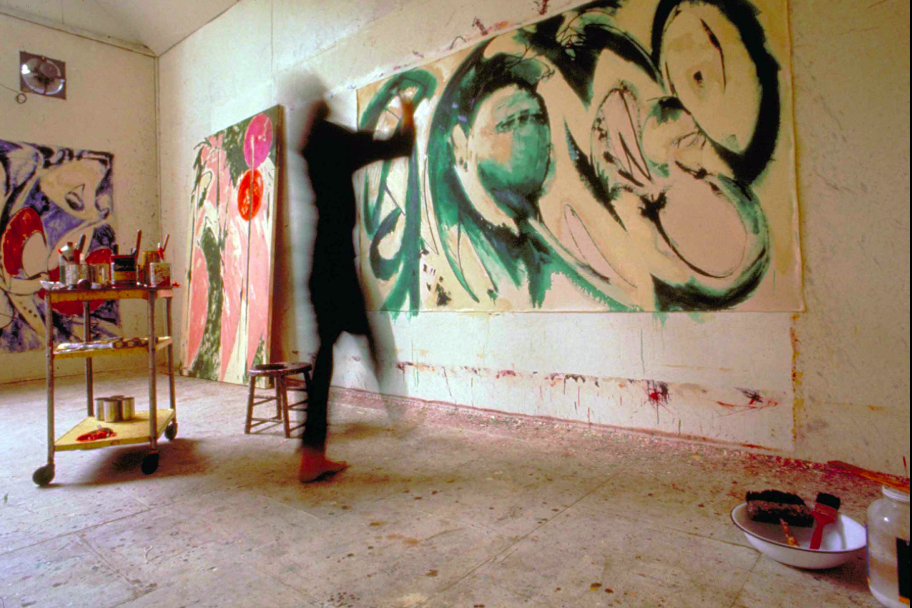 Lee Krasner painting Portrait in Green in her studio in Springs, NY,1969. Photograph by Mark Patiky